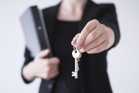 real estate agent handing over the keys to a new house
